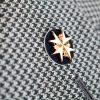 St. John lapel badge